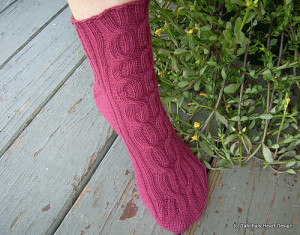 Cabled multi-sized sock.