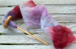 Felted fiber fluffed and being spun