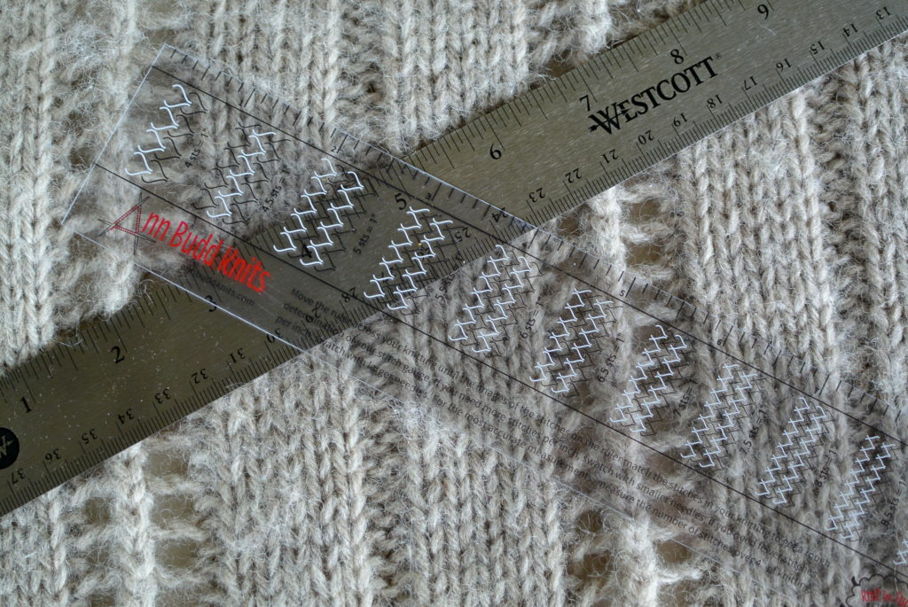 Measuring knitting gauge.